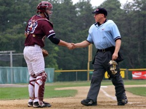 Catcher and umpire shaking hands